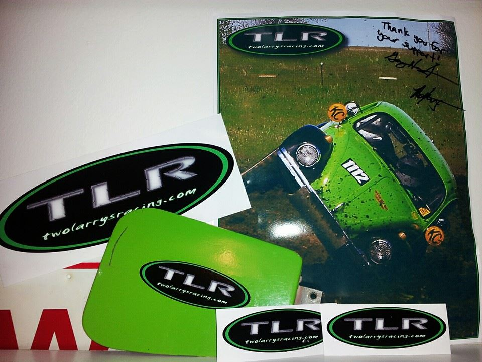 Photo provided by Jessica Johnston. Included in her care package were two small TLR stickers, one large, an autographed photo of the Green Booger, and a piece of the BOOGER ITSELF! For her care package, she was sent the infamous green gas door flap from Booger v1.0 circa 2009, which amazingly never came open in all four years of Class 11 racing.
