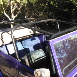 Cage does not interfere with the latches for the soft top, or the latches for the windshield.