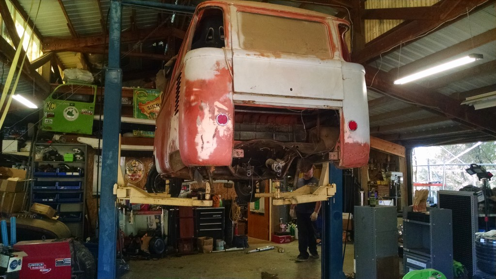 Bus on the lift. It hasn't moved in almost 15 years. We moved it with two jacks and both of us pushing/pulling.
