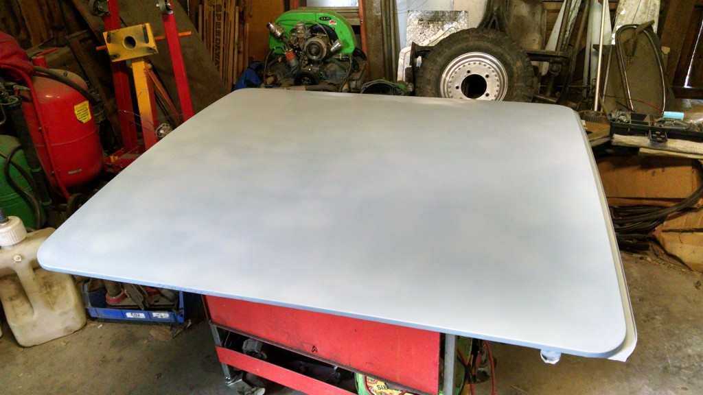 A quick coat of primer applied (still wet in this picture) to the sunroof.